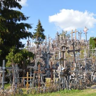'Planted here since the 14th century, the crosses were bulldozed by the Soviets, but each night people crept past soldiers and barbed wire to plant more, risking their lives or freedom to express their national and spiritual fervour'
