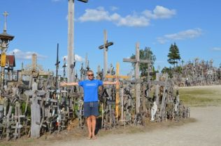 Craig being a cross at the Hill of Crosses