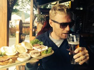 Craig with his Polish beer and local food.